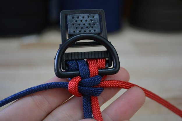 Push up with your thumb and pull the cords | Learn To Make A Paracord Dog Collar | Instructions