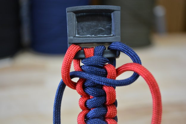 Loop the red cord under and through the blue loop | Learn To Make A Paracord Dog Collar | Instructions