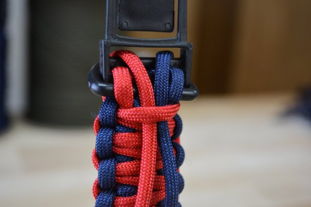 Turn the collar over and thread the ends of the cord | Learn To Make A Paracord Dog Collar | Instructions