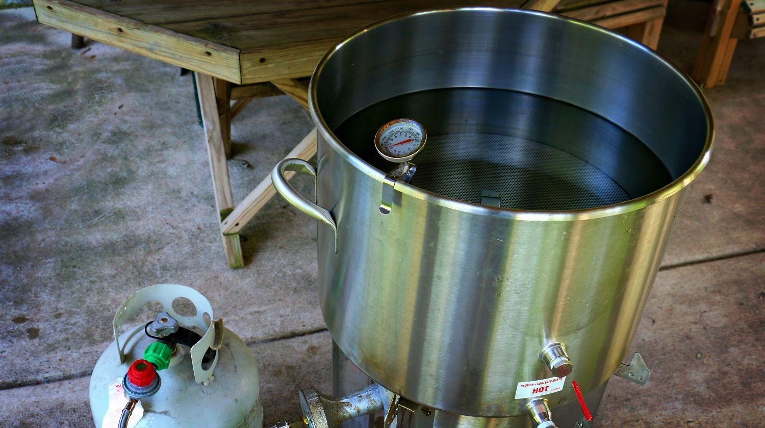 Featured | Heating water to make home brewed beer | How To Make A Still | Self Reliance