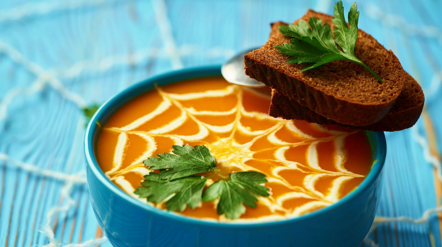 A healthy pumpkin puree garnished with cream and parsley leaves | Healthy Halloween Recipes | Easy Recipes For A Healthier Halloween | Featured