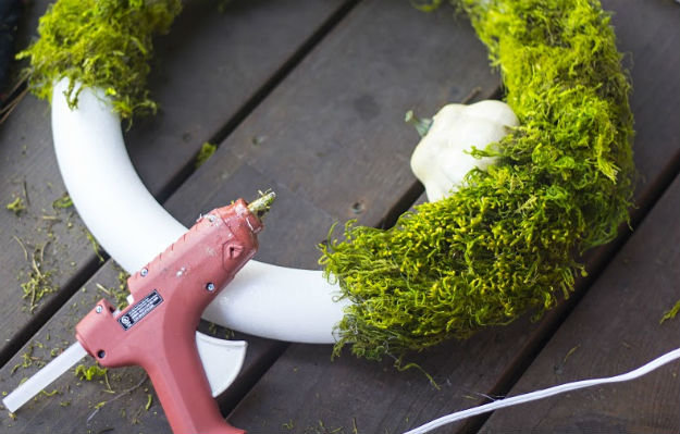Cover the foam wreath with moss