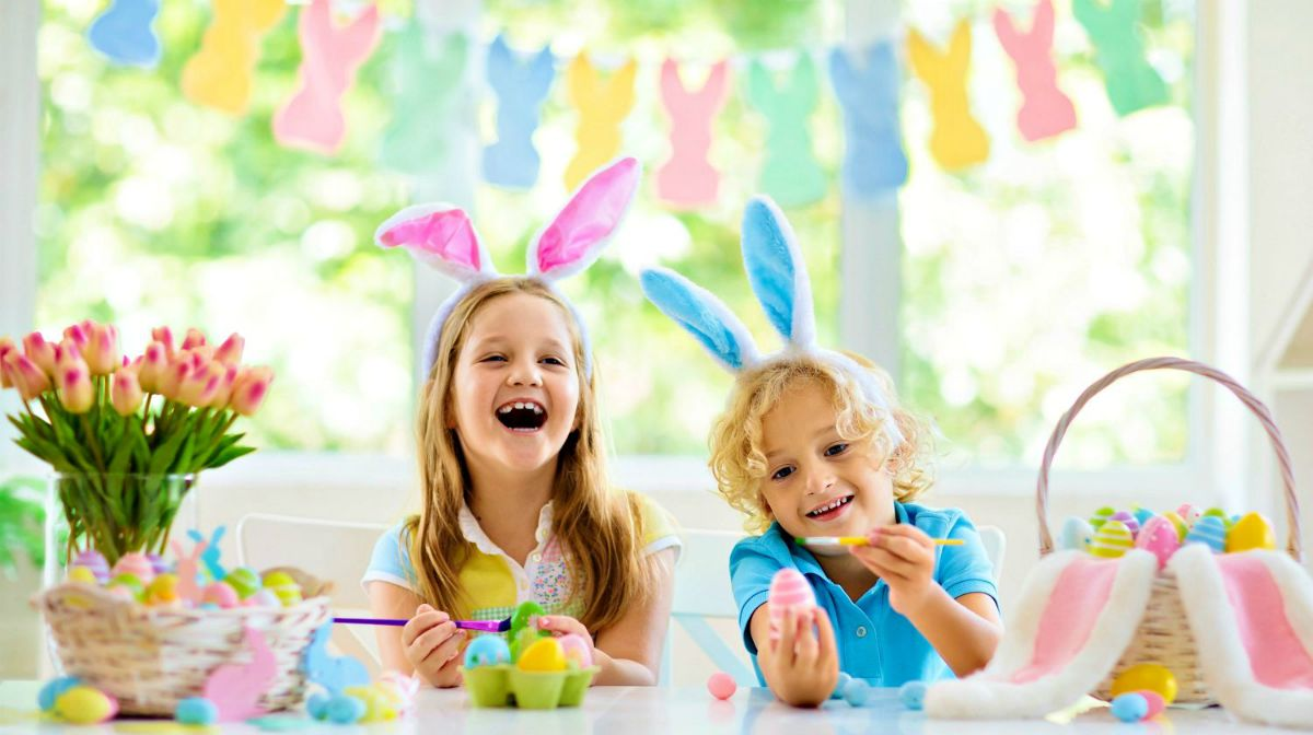 Children in bunny ears dye colorful egg for Easter hunt | Easter Crafts, Recipes, And Cool DIY Ideas For Your Celebration