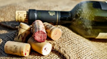 Feature | Red wine bottle beside wine corks | More DIY Wine Cork Crafts Ideas