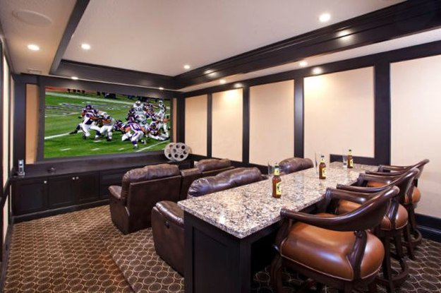 Big Screen TV in three level home Entertainment Movie Room and Bar. | 10 Man Cave Ideas For Real Men https://diyprojects.com/man-cave-ideas-for-real-men/