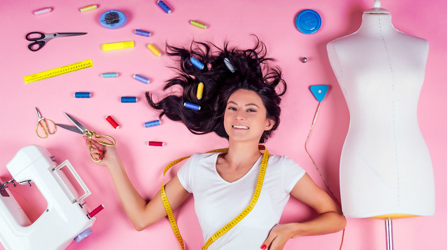 Featured | Young woman designer,sewing machine and maniken in studio pink background | More Sewing Hacks To Make Your Life Easier