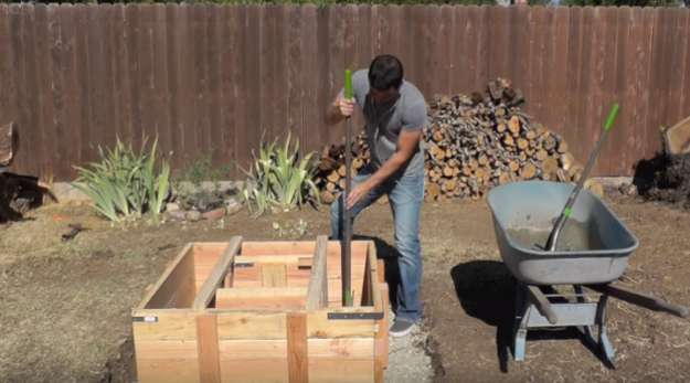 Pour in the concrete | Turn Your Backyard Into A Camping Area With This DIY Outdoor Fire Pit