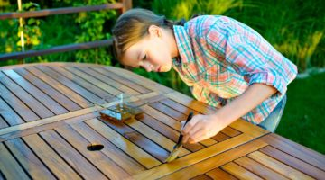 Feature | Girl painting and applying varnish on a wooden table | Woodworking Projects For Kids