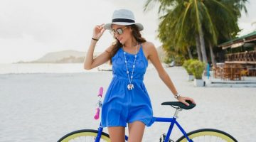 lady in blue leaning on a bike | DIY Summer Fashion Tips To Beat The Heat