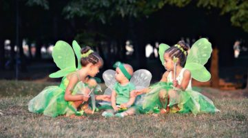 Baby and two girls in green fairy costumes with wings in the park | DIY Tinkerbell Costume Ideas | Featured