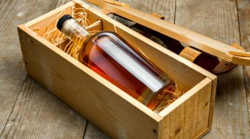 Bottle of liquor aged fine craft whiskey bourbon rum tequila gift package shipping   Super Cool Reclaimed Wood Craft Ideas And DIY Projects   Featured
