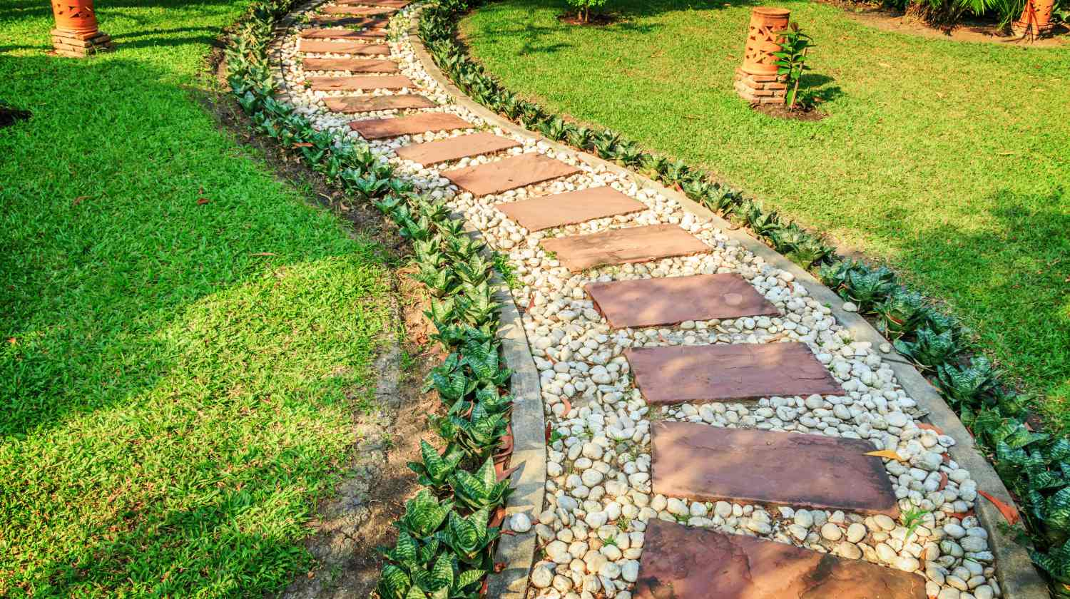 Featured | A stone walkway in the outdoor green garden | DIY Walkway Ideas To DIY Before Summer Begins