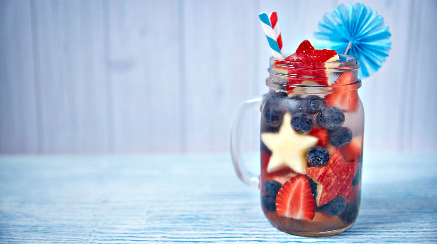 Feature | Patriotic drink cocktail with strawberry, blueberry and apple | 4th Of July Drink Recipes In Mason Jars To Mix At Home