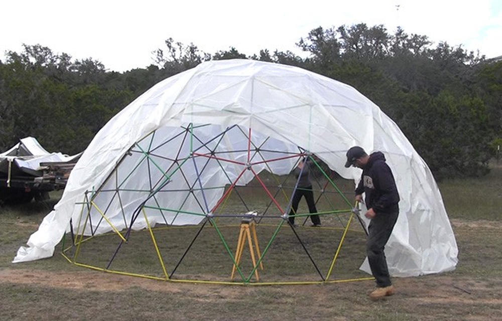 Placing plastic cover | How To Build A Geodesic Dome: 268 Square Feet for $300 | geodesic dome design