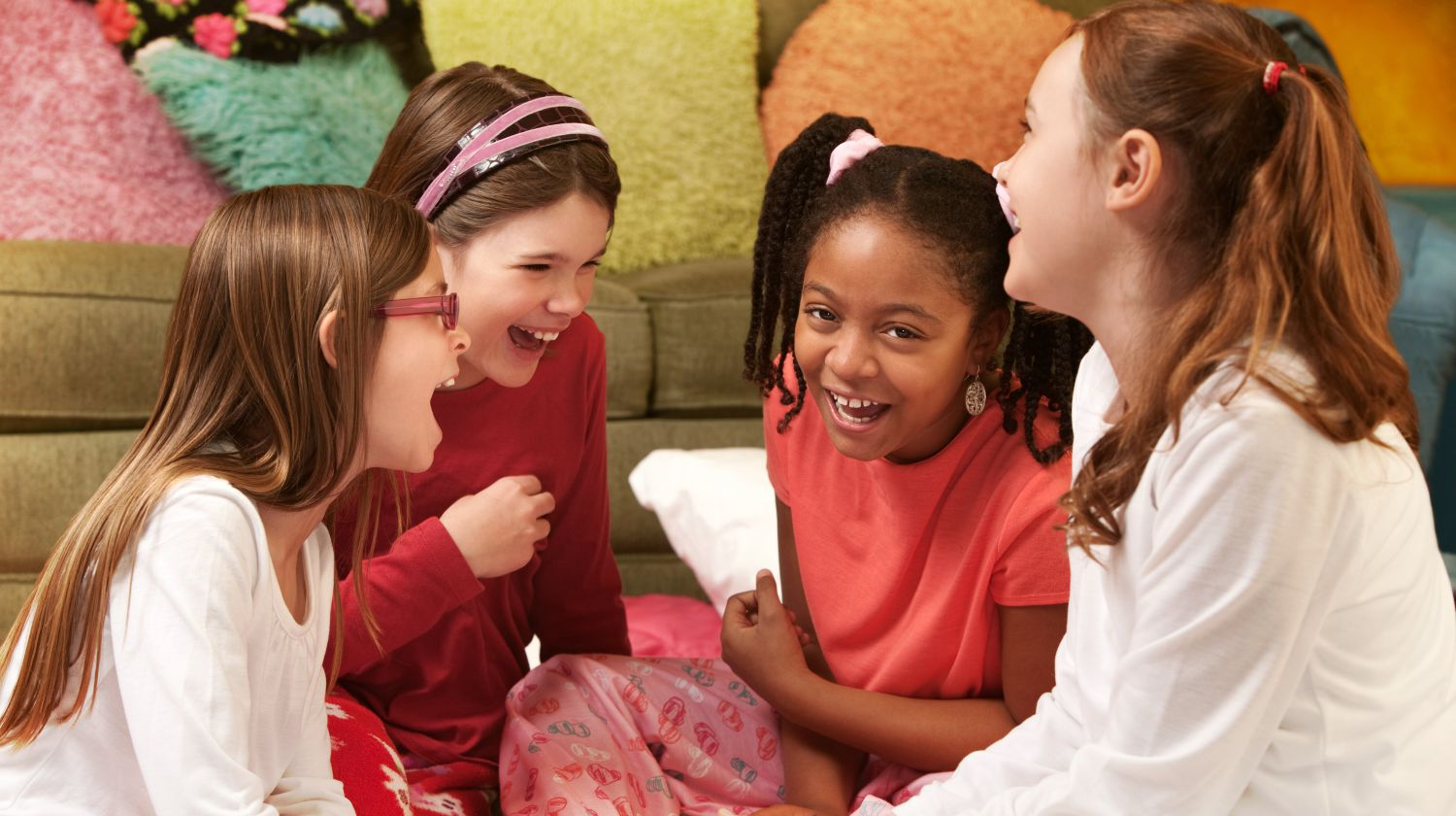 Feature | Happy girls in pajamas at a sleepover | Activities For A Sleepover | Fun Slumber Party Ideas