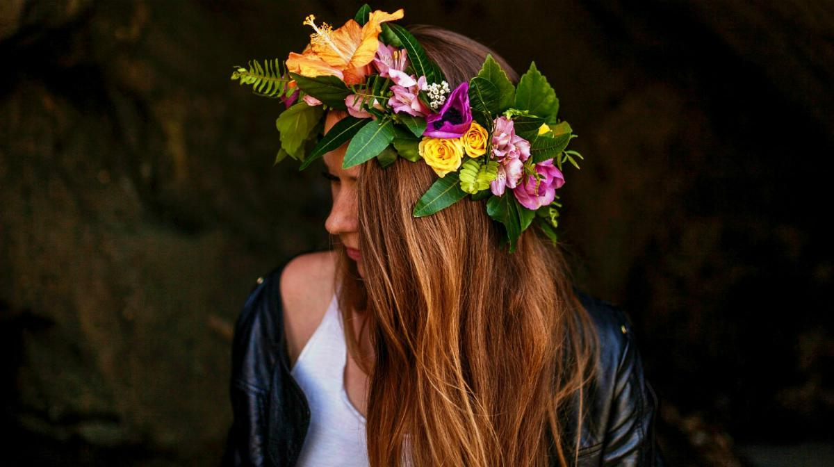 Woman wearing flower crown | DIY Beach Party Ideas For Your Beach-Themed Celebration