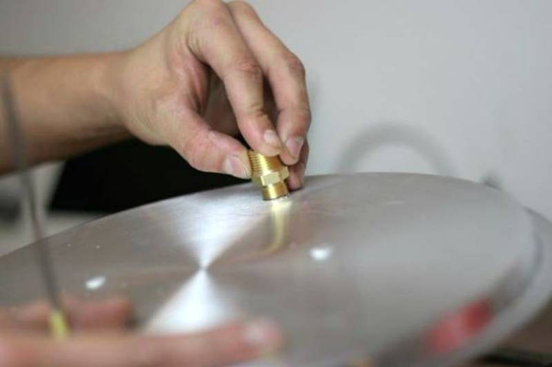insert a compression fitting into the lid | Learn How To Make A Still For Self Reliance