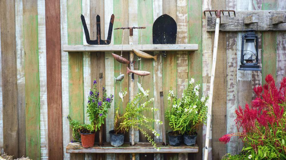 farm equipment on wooden wall with plants | Easy Lawn And Garden Tool Storage Pallet Project | How-To | Featured