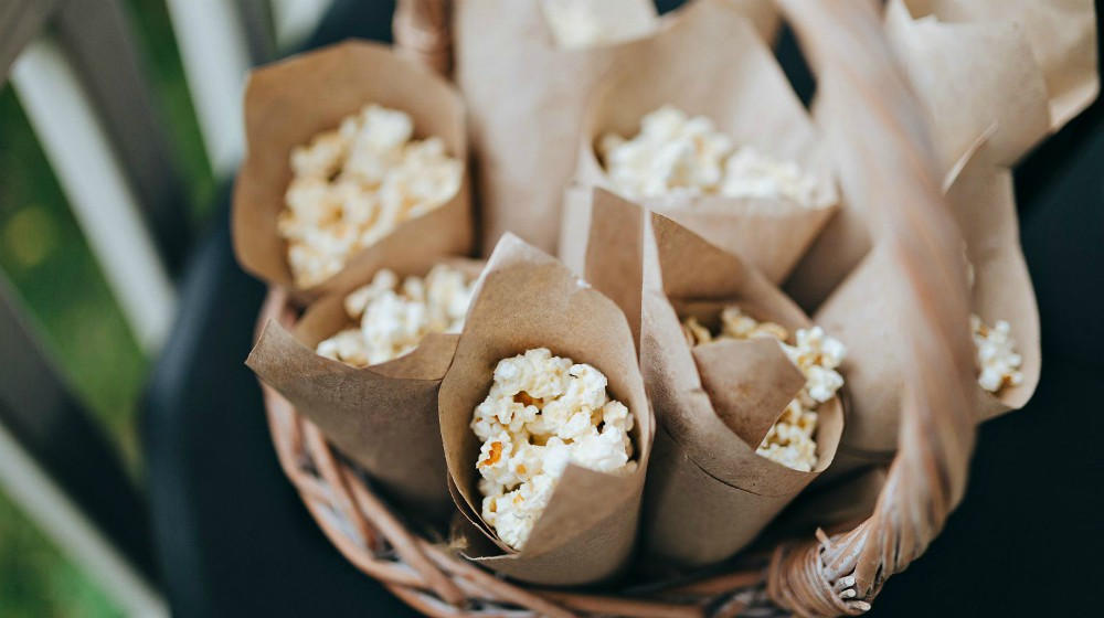 Crafting the package with popcorn lying in a wicker basket | DIY Gifts For Dad | Rustic Popcorn Sampler | Featured