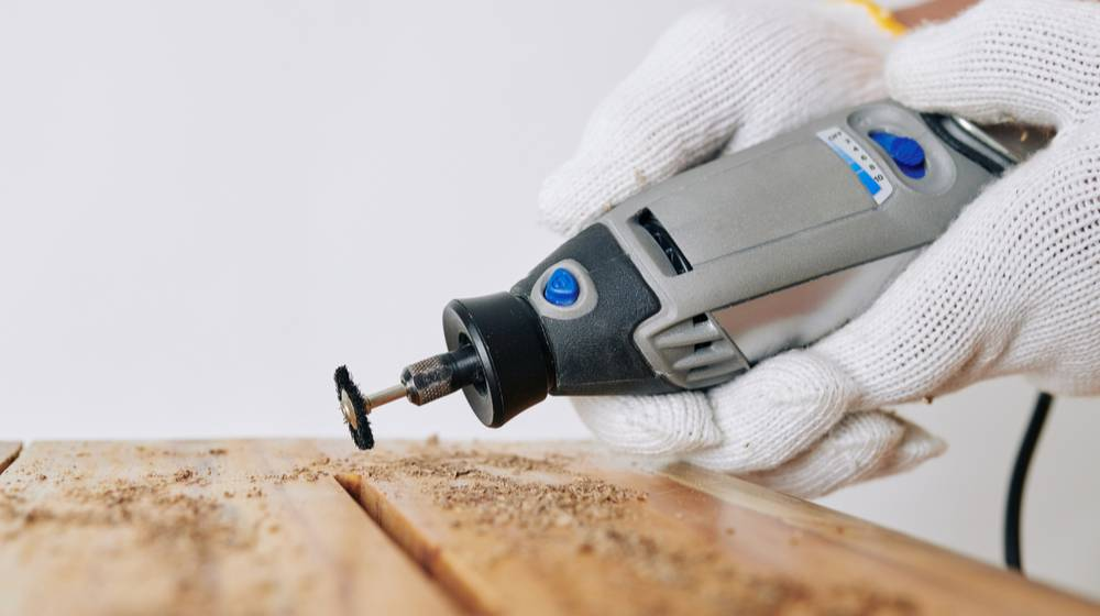 professional-carpenter-using-rotary-hand-tool | 10 Ways To Use Your Rotary Tool | Featured