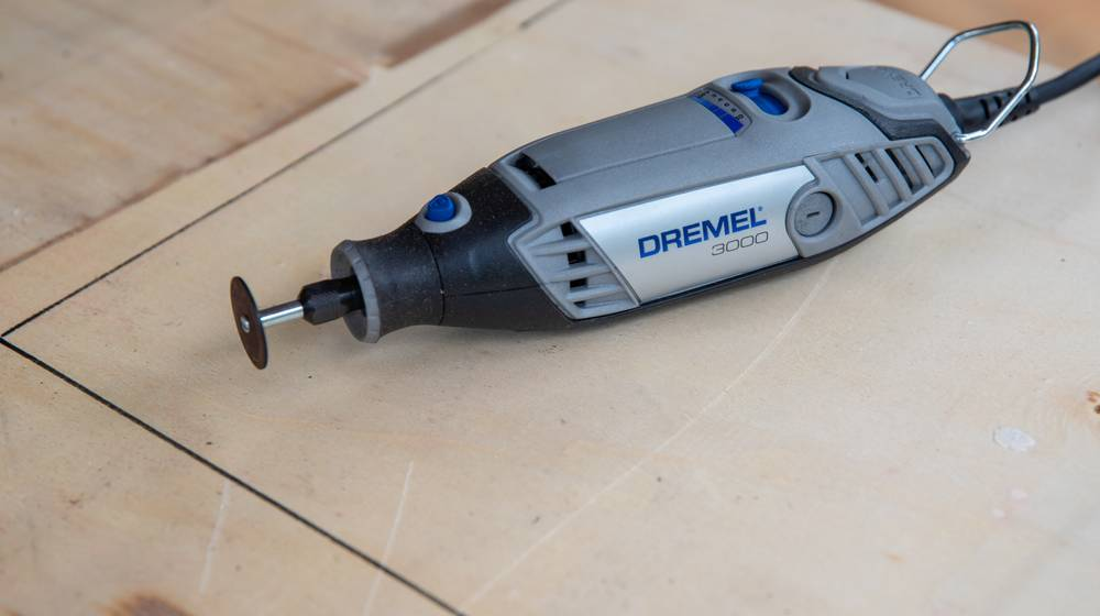 Multitool-on-a-wooden-board-used-for-craft-project | Which Dremel Tool Is Right For You? | Featured