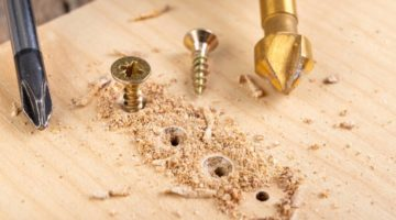 screwing-metal-screws-into-chipboard-furniture | How To Properly Fix A Stripped Screw Hole | Featured