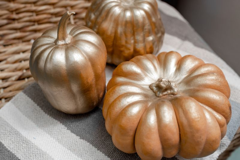 three-pumpkins-different-shapes-covered-golden | thanksgiving crafts for adults