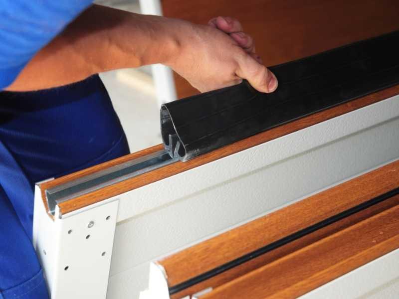 MAC4OQNJijA-contractor-installing-garage-door-weatherproofing-garage-door-seal-replace-garage-door-seal | crawl space insulation r-value
